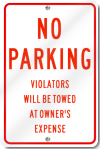 No Parking Violators Will Be Towed Sign in Red